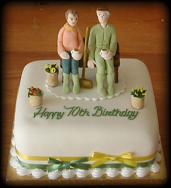 Birthday-Cakecouple-on-bench.-70th-bdayCelebration-Cakes.jpg