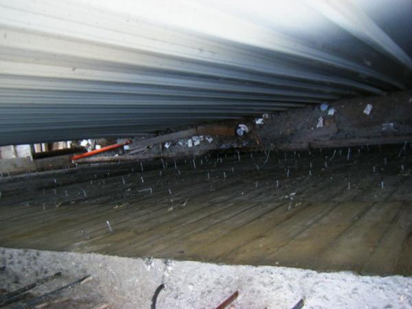 091214-一樓頂板養護3及拆側模07