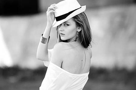 beautiful-young-lady-in-white-backless-shirt-and-hat.jpg