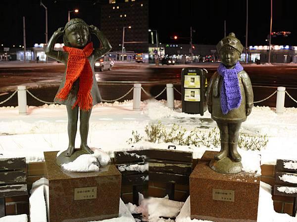 路旁二個像是姐弟的雕像,天氣太冷當地人還幫他們圍圍巾呢
