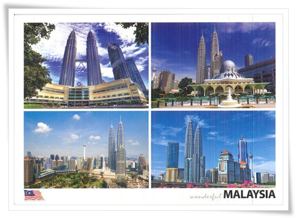 the petronas twin towers and the kuala lumper tower.jpg
