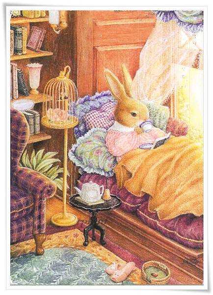 bunny reading on bed.jpg