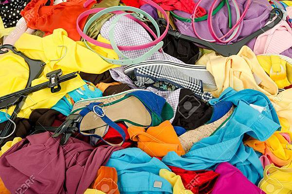 28830719-Close-up-on-a-big-pile-of-clothes-and-accessories-thrown-on-the--Stock-Photo.jpg