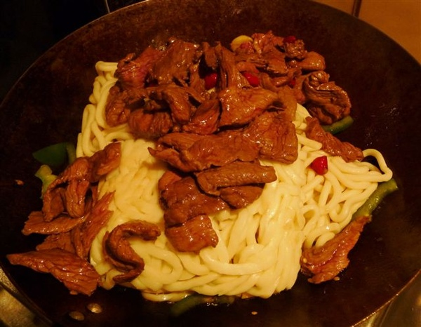 step 4-add noodles and beef and then stir fry.JPG