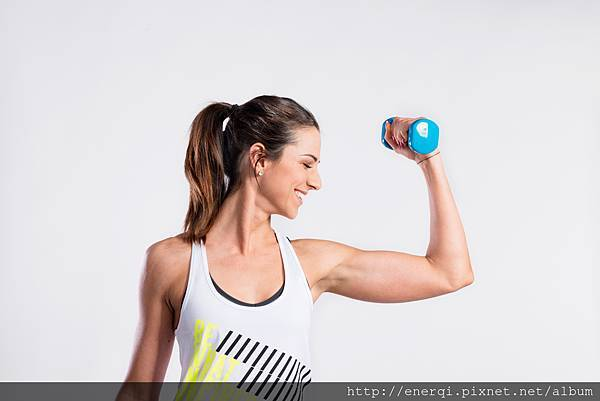 graphicstock-attractive-young-fitness-woman-in-white-singlet-working-out-with-dumbbell-slim-waist-perfect-fit-female-body-studio-shot-on-gray-background_BuerkCY8G-.jpg