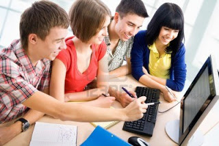13622944-young-students-studying-together-in-a-classroom.jpg