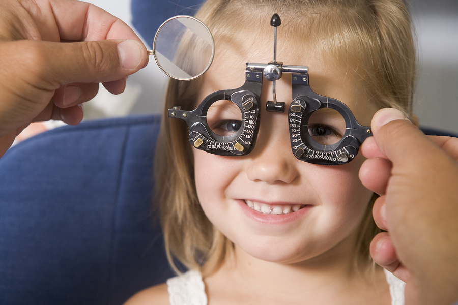 bigstock-Optometrist-In-Exam-Room-With--4137225