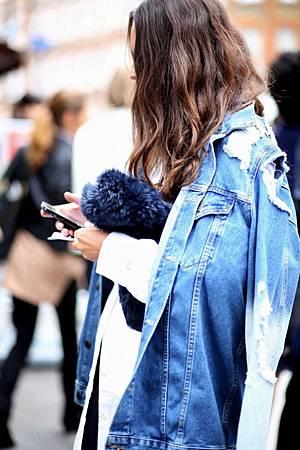 Le-Fashion-Blog-Street-Style-Distressed-Denim-Jacket-Fur-Clutch-London-Fashion-Week-Via-Elen-Kristvik