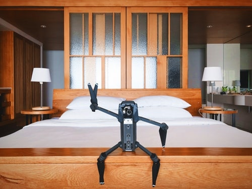 black quadcopter drone on brown wooden table.jpg