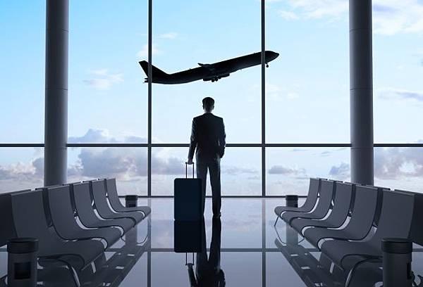 ManInAirportWatchingPlane650.jpg