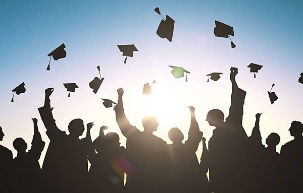 GraduationHatsThrownIntoTheAir-1400x891.jpg