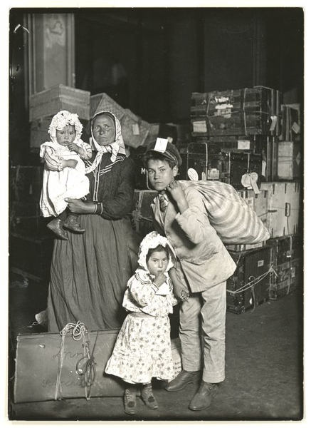 lewis-hine-italian-family-looking-for-lost-baggage-ellis-island-1905.jpg