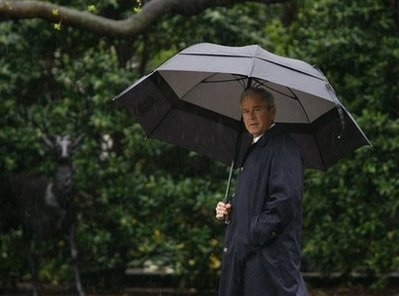 president-bush-carries-an-umbrella-2.jpg