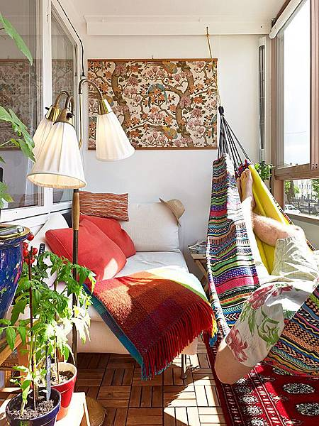Apartment-Balcony-Decorating-Ideas-With-Cool-Colorful-Boho-Chic-Balcony-Decor-With-white-sofa-and-red-pillows-and-colorful-swing-chair-and-red-rug-and-wooden-floor.jpg