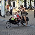 cargo bike with two kids and skirt