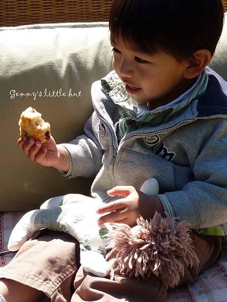 Joshua eats cranberry scones 2.jpg