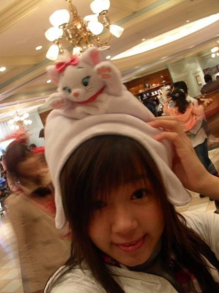 ㄚ頭戴小貓咪帽子.jpg