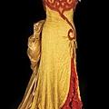 瑪麗蓮夢露在【大江東去】 River of No Return (1954)裡所穿的紅黃相間洋裝。