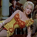 "Marilyn Monroe ""Kay Weston"" gold charmeuse saloon-girl gown by Travilla for River of No Return sold for 510,000 USD"