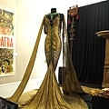 Claudette Colbert signature gold-lamé and emerald boudoir gown by Travis Banton from 1934 sold for 40,000.00USD