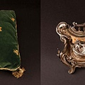 Intricate heavy silverplate inkwell, linen and lace tablecloth, and green pillow from Desirée sold for 1,600.00USD