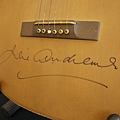 "Julie Andrews ""Maria"" acoustic guitar, autographed by Andrews, from The Sound of Music sold for 140,000 USD"