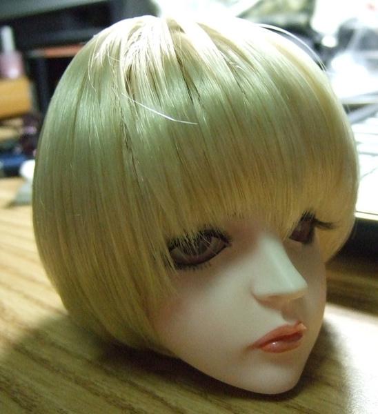 超可愛的頭毛...