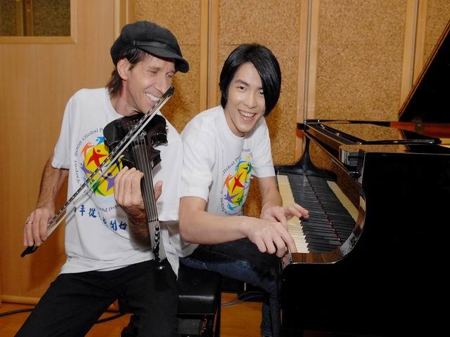 更改大小為錄製2009全球和平大會主題曲蕭敬騰首度跨國與葛萊美小提琴手JAMII合作,讓愛跨越國界傳唱出來.jpg