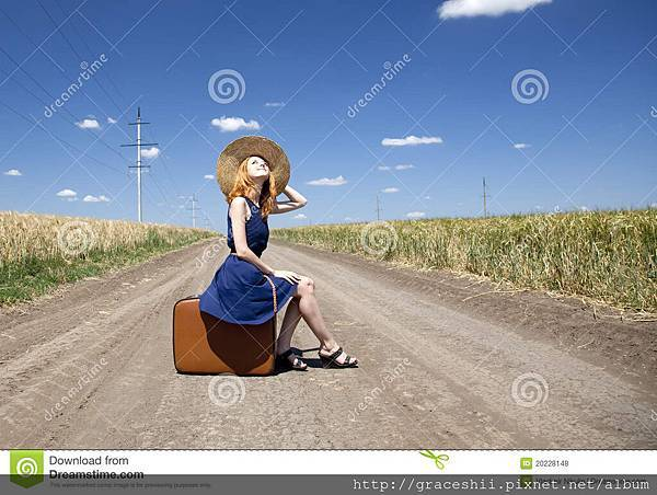 lonely-girl-suitcase-country-road-20228148