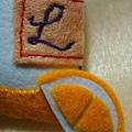 """柑橘片和獨家""""L""""標誌"""