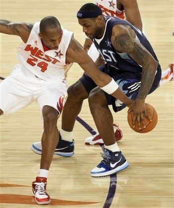 Kobe Bryant pokes the ball away from Lebron James at the All Star Game 2009