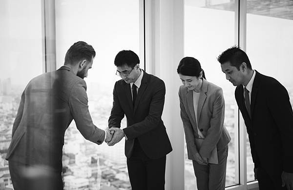 japanese-businessman-people-having-handshake-with-colleague.jpg