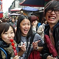 The Japan volunteer was tasted the local dessert-Tomatoes on sticks.