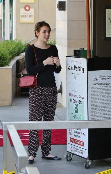 emma-roberts-and-coach-legacy-leather-penny-shoulder-purse-gallery.jpg