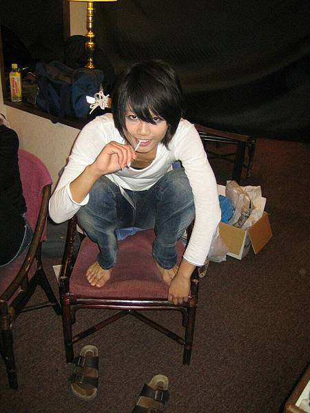 L n his chair