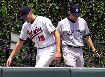 Jason Johnson warms up in the bullpen as Mike Mussina.jpg