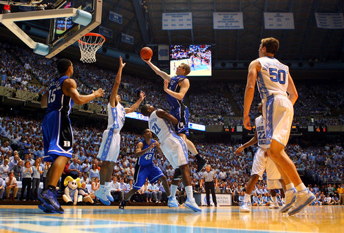 Kyle-Singler-12-of-the-Duke-Blue-Devils-charges-over-Deon-Thompson-21-of-the-North-Carolina-Tar-Heels-during-their-game-at-the-Dean-E-Smith-Center-on-March-8-2009.jpg
