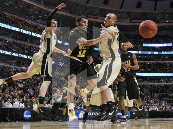 virginia-commonwealth-university-basketball-m-2011-tournament-joey-rodriguez-dj-byrd-ryne-smith-vcu-mbk-11tou-00037xlg.jpg