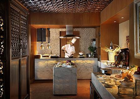 Chef cooking in the club lounge kitchen.JPG