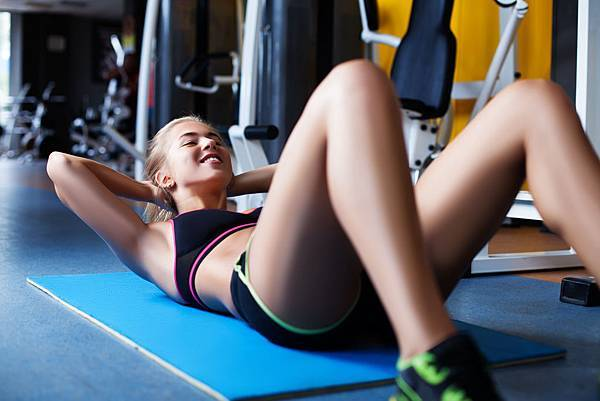 girl-exercising-abs-PKTTJYP.jpg