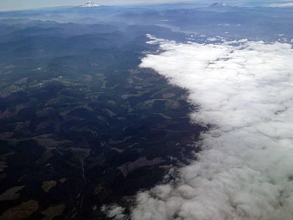 飛往西雅圖的路上