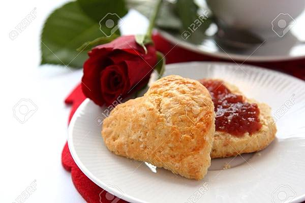 17410928-Heart-shaped-scones-with-strawberry-jam-and-a-cup-of-tea-Stock-Photo.jpg