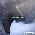 水壩洩洪形成彩虹