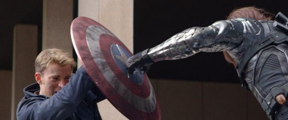 Captain-America-The-Winter-Soldier-Official-Photo-Bucky-punching-Shield-570x238