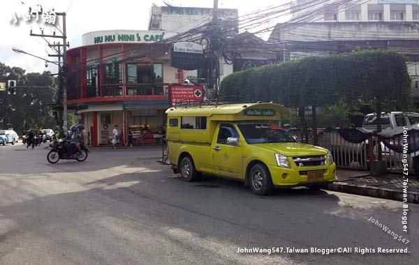 Yellow Songthaew Chiang Mai gate.jpg