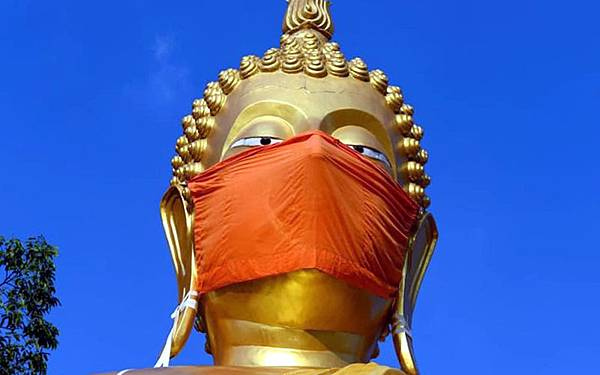 Wat Nithet Rat Pradit Buddha wears mask.jpg