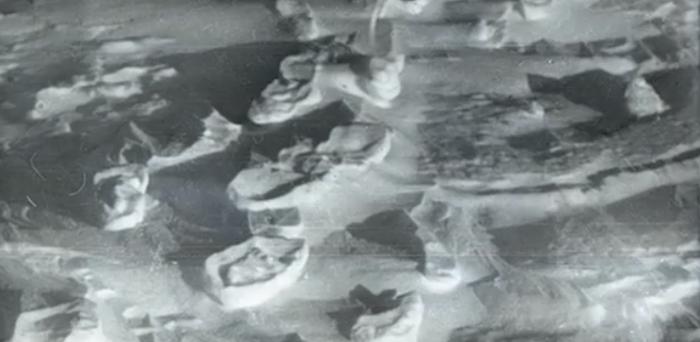 Photo of footprints of nine people leaving the tent