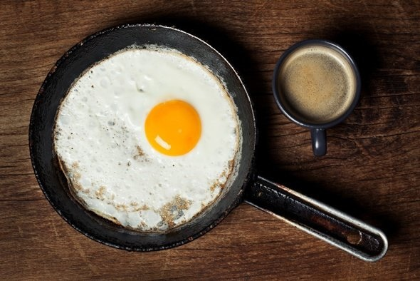 fried-egg-and-coffee-on-wooden-table.jpg