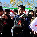 "A group of Chinese college students show off their World AIDS Day ""Red Ribbon"" health   packs which include packets of condoms, during a campaign in Liaocheng, Shandong province   on December 1, 2013. UNAIDS estimates that there are 780,000 people living with HIV in   China. CHINA OUT AFP PHOTO (Photo credit should read STR/AFP/Getty Images)"