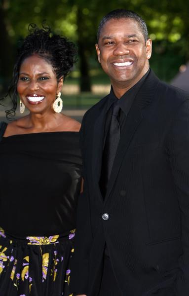 2008年6月25日,丹澤爾‧華盛頓夫婦參加在倫敦海德公園舉辦的曼德拉90歲壽宴。很多名流在這一周內拜會了在倫敦逗留的曼德拉。(Leon Neal/AFP/Getty Images)